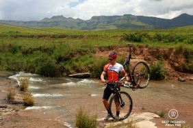 River crossing mountain biking the Northern Drakensberg, South Africa