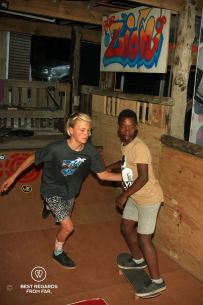 Kye McGregor coaching Nemato Change a Life member Liyema at Shaka Surf School, Port Alfred, South Africa