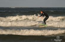 Managing to ride a wave in the foam, Shaka Surf School, Port Alfred