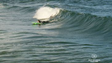 Peddling hard to catch that wave, Shaka Surf School, Port Alfred, South Africa
