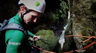 Marthinus Esmeyer is setting up the ropes to slide down, canyoning George, South Africa