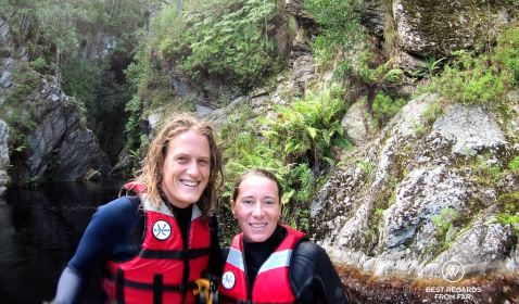 Marcella and Claire getting out of the canyon, kloofing George, South Africa