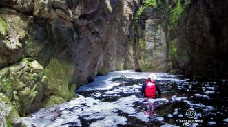 Wading through, canyoning George, South Africa