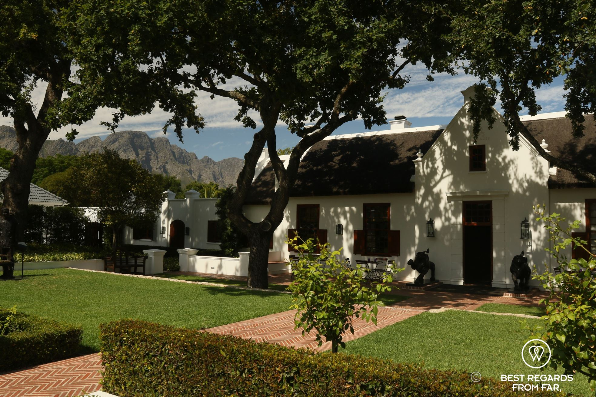 Traditional Cape Dutch estate with a thatched roof in Franschhoek, South Africa