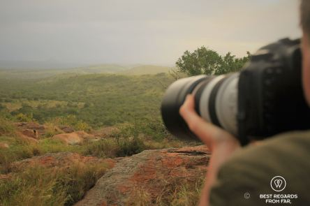 Photographer Claire Lessiau tasking a shot of lionesses on a rock at sunset at &Beyond Phinda Private Game Reserve, South Africa.