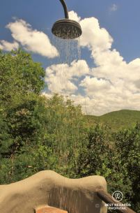 Outdoor shower at the exclusive Rock Lodge at &Beyond Phinda Private Game Reserve, South Africa.