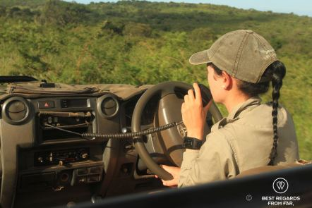 A ranger in her 4x4 in the bush at &Beyond Phinda Private Game Reserve, South Africa.