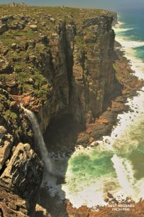 Mfihilo waterfall falling into the Indian Ocean, Wild Coast hike, South Africa