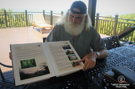 Kingsley Holgate flipping the pages of one of his Scroll of Peace and Goodwill at his Africa House, South Africa
