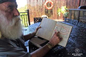Kingsley Holgate showing one of his note books that he writes during his expeditions