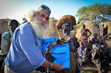 Kingsley Holgate handing out mosquito nets, photo by the Kingsley Holgate Foundation