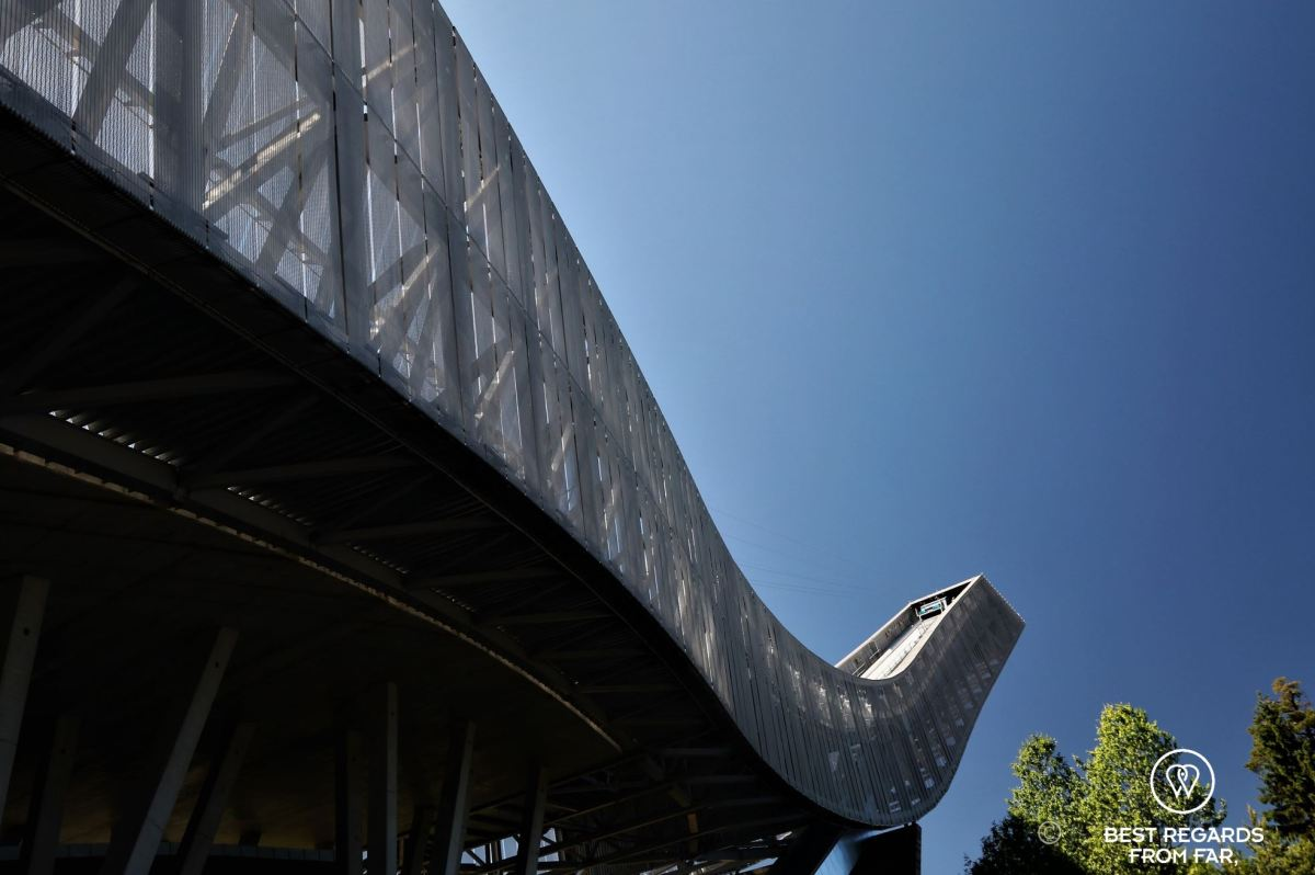 Close-up of the Holmenkollen Ski Jump on a sunny day in Oslo.