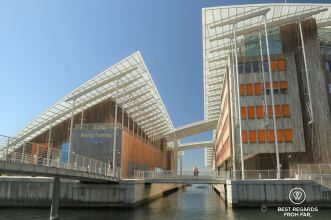 Modern building over water with orange shades. Astrup Fearnley Museum of Modern Art, Oslo