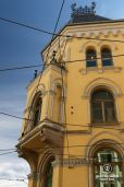 Classy yellow building, tram lines and blue skies, Oslo, Norway