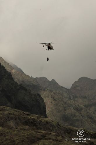 Helicopter airlifting up the wounded in changing weather conditions on Stage 3 of the GR 20, Corsica, France