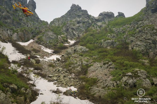 Helicopter lowering a medic to rescue the wounded on Stage 3 of the GR 20, Corsica, France