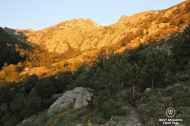 Mountain peaks bathed by sunrise light on Stage 10 of the GR 20, Corsica, France