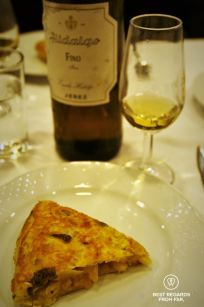 Perfectly cooked tortilla with a dry Hidalgo Fino wine, Madrid, Spain