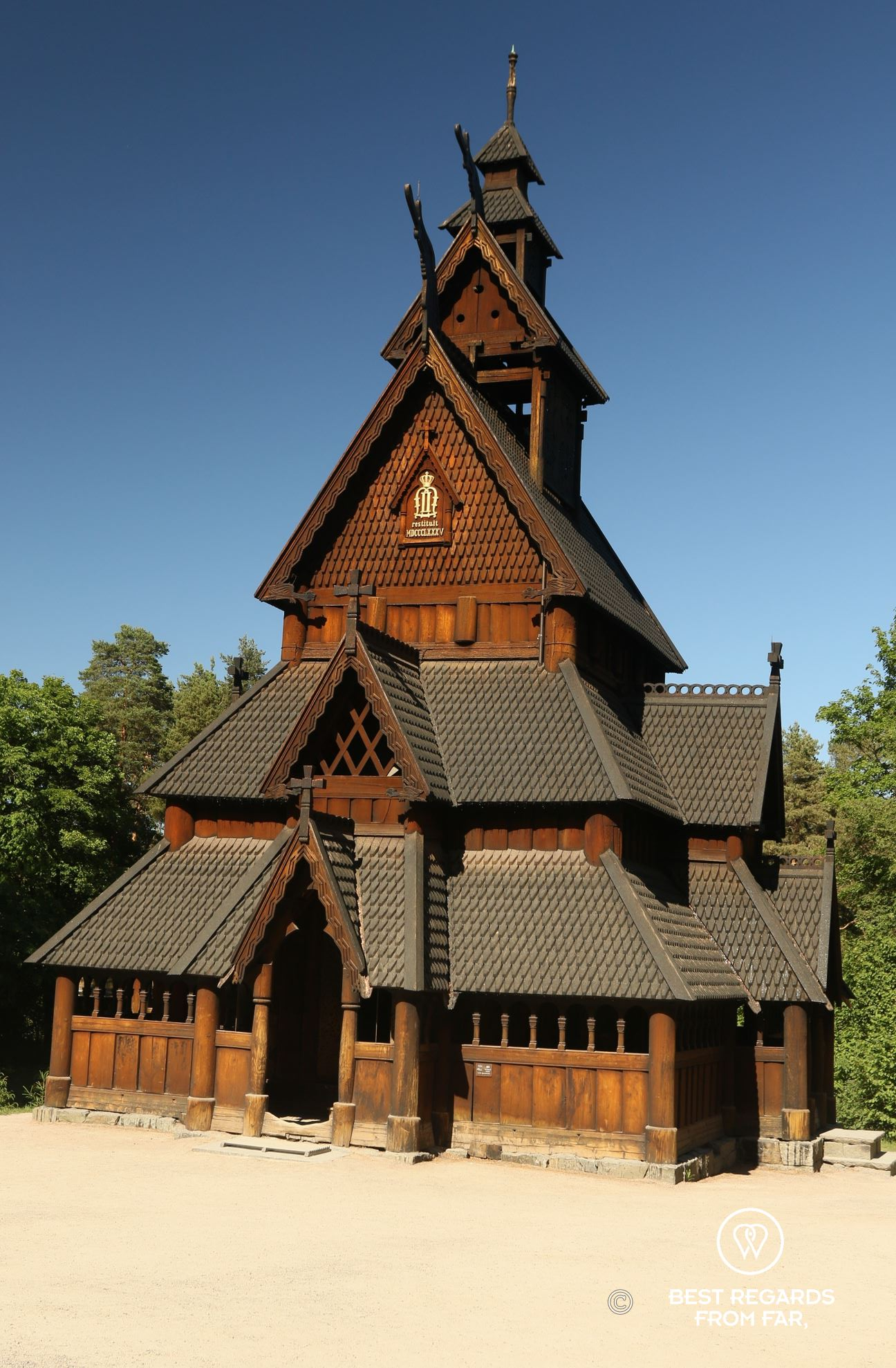 Traditional Norwegian wooden Stave Church, blue skies.