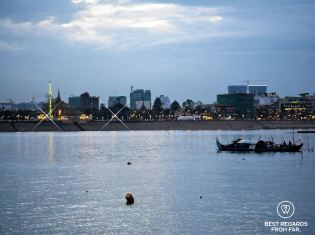 Skyline of Phnom Penh from a sunset Mekong cruise, Cambodia