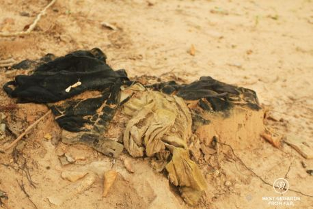 Clothes of one of the many victims in the mass grave, Phnom Penh Killing Fields, Cambodia