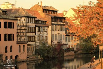 Petite France typical architecture by the canal bathed in sunset light, Strasbourg, France