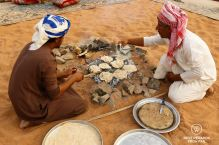 Gursh bread being baked in the desert, Oman