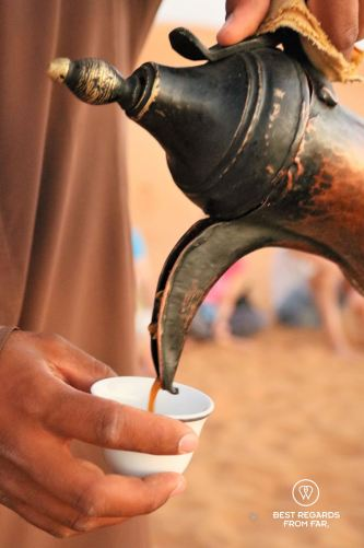 Kahwa served in the desert from a brass coffee pot, Oman