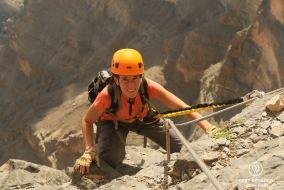 Claire on the via ferrata in Jebel Shams, Oman