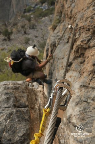 Climbing up the via ferrata in Jebel Shams, Oman
