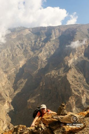 Climbing up the via ferrata in Jebel Shams, Oman