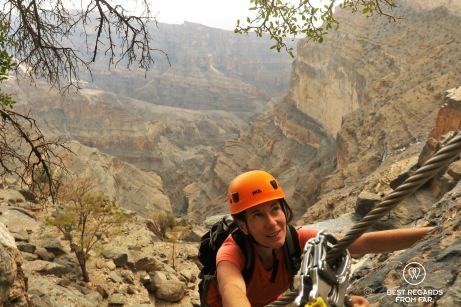 Claire on the via ferrata in Jebel Shams, Oman