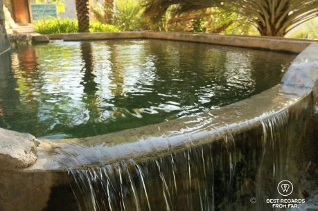 Large basin in Misfat Al Abriyeen, filling the falaj system, Oman