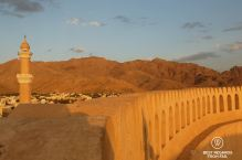 Mosque bathed in the light of the setting sun, Nizwa Fort, Oman