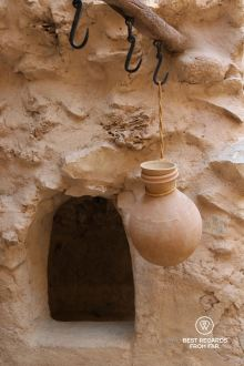 Cooling down water in a traditional water jar, Nizwa Fort, Oman