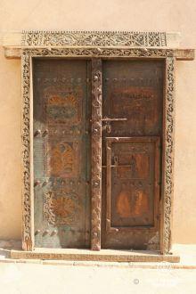 Wood carved door in the Nizwa Fort, Oman
