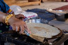 Woman baking Kuboos in the Nizwa Fort, Oman
