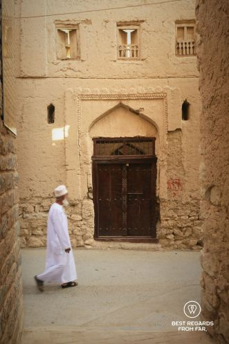 Old man walking the streets of Old Nizwa, Oman