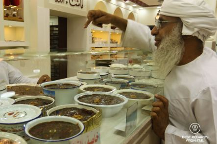 Local man buying the sweet Halwa at the Nizwa Souq, Oman