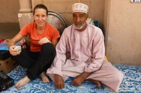 Drinking Omani coffee with a local market vendor, Nizwa