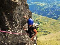 Rock climbing the Maïdo Peak with the Cirque of Mafate as a backdrop, Reunion Island