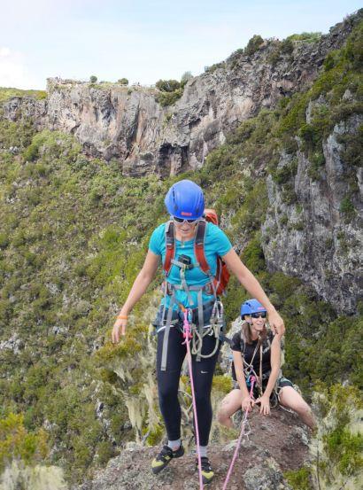 Reaching the summit of the Maïdo Peak after a 200-meter rock climb, Reunion Island