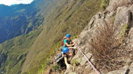 Rock climbing the Maïdo Peak with the Cirque of Mafate as a backdrop, Reunion Island