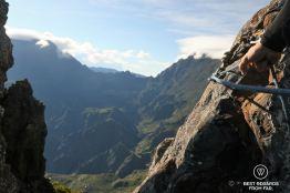 Secured to rock climb the Maïdo Peak, Reunion Island