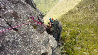 Analyzing the situation rock climbing the Maïdo Peak, Reunion Island
