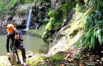Our mountain guide taking care of gear, canyoning the Reunion Island