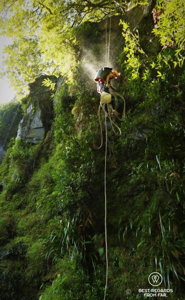 Olivier abseiling the Sainte Suzanne Canyon, the Reunion Island