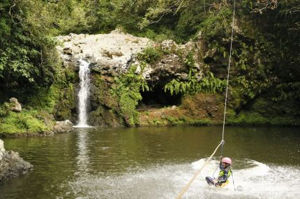Zip-lining into the Sainte Suzanne Canyon, the Reunion Island
