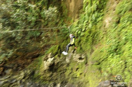 Zip lining in the Sainte Suzanne Canyon, the Reunion Island
