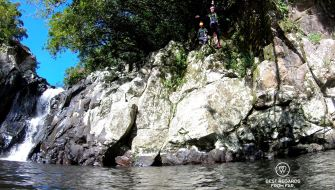 Claire jumping into the Sainte Suzanne Canyon, the Reunion Island